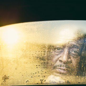 man looks through window