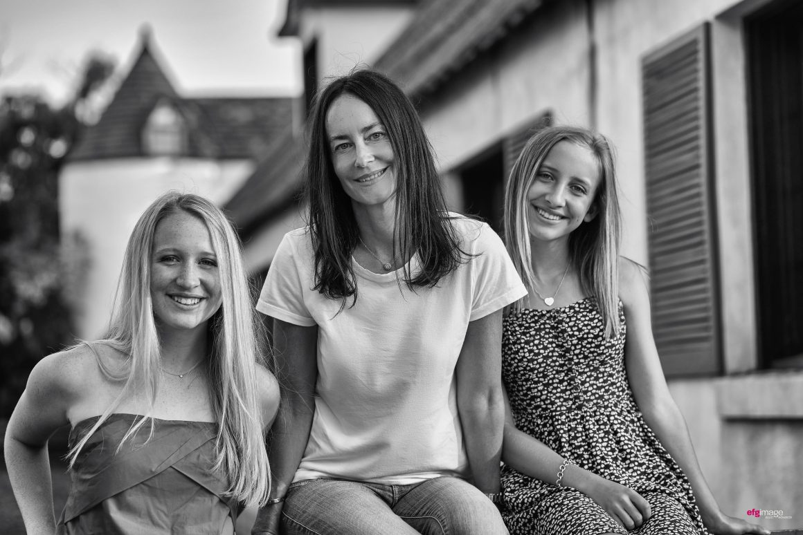 Mom with two beautiful daughters at farm